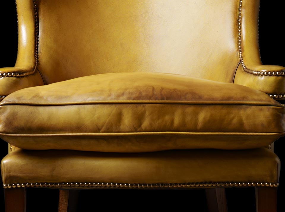 gold jonathan swift chesterfield chair