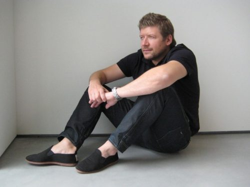 davig fox sitting on the floor in black