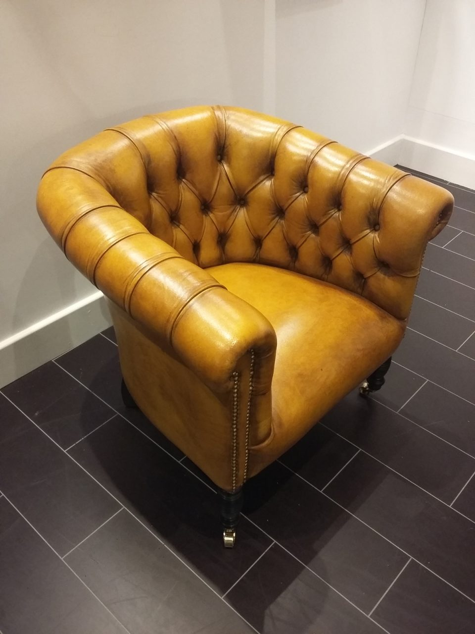 mustard chesterfield chairs