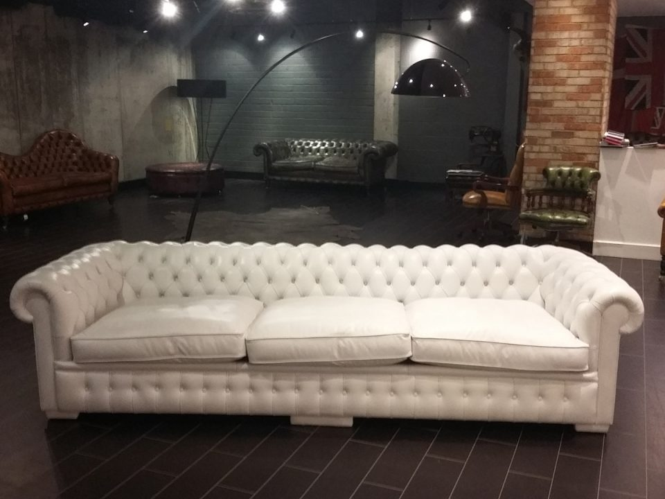 white chesterfield in showroom